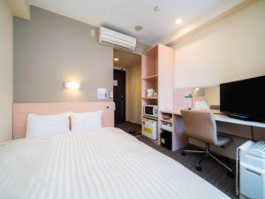 Кровать или кровати в номере Super Hotel Osaka Natural Hot Springs