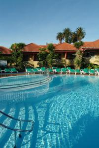The swimming pool at or near Pestana Village Garden Hotel