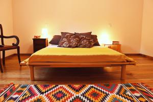 A bed or beds in a room at Casa Ana Monteiro