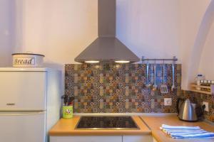 Кухня или мини-кухня в VillaVie