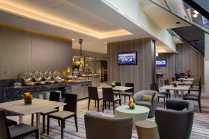 A restaurant or other place to eat at Carlton Hotel Singapore (SG Clean, Staycation Approved)