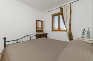 Postel nebo postele na pokoji v ubytování Apartments and Rooms LEA