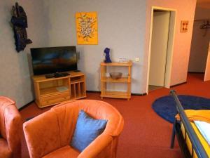 Ein Sitzbereich in der Unterkunft Pension Lange