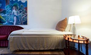 Säng eller sängar i ett rum på Frimurarehotellet; Sure Hotel Collection by Best Western