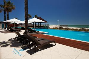 The swimming pool at or near Seashells Mandurah