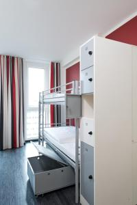 A bunk bed or bunk beds in a room at ONE80° Hostels Berlin