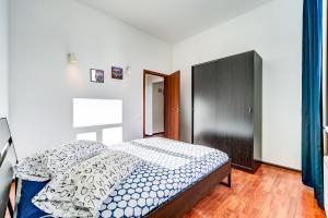 Кровать или кровати в номере La Casa Di Bury Apartments 1