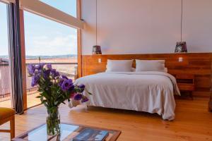 Cama o camas de una habitación en Augusta Hotel