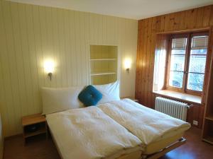 Ein Bett oder Betten in einem Zimmer der Unterkunft Domaine du Burignon