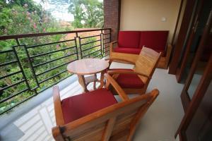 A balcony or terrace at Villa Ubud Sunshine