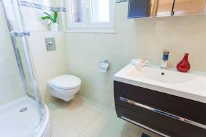 Kúpeľňa v ubytovaní Villa Augusta Pasadur