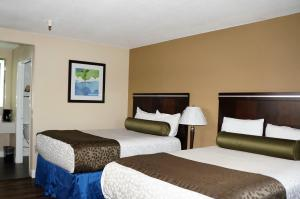 A bed or beds in a room at Executive Inn