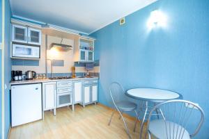 A kitchen or kitchenette at Apartment Prospect Lenina