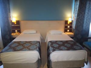 Кровать или кровати в номере Laodikya Hotel