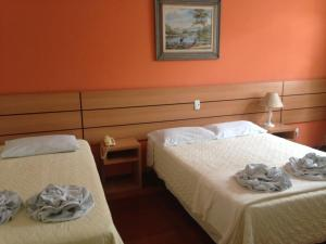 A bed or beds in a room at Hotel Colonial Aquarius