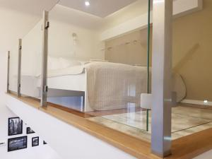 A bed or beds in a room at Renaissance Studio Apartment