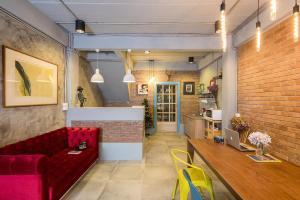 The lobby or reception area at Sleep Well DMK Hostel