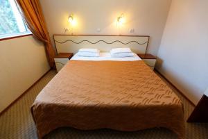 Кровать или кровати в номере Пансионат Радуга