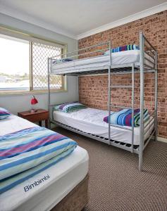 A bunk bed or bunk beds in a room at Bimbimbi 2, 11 Willow Street