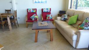 A seating area at AB's Exclusive Condo, 19a Dulconghi Street
