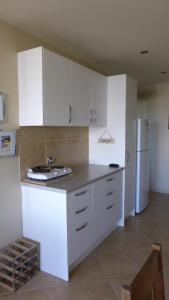 A kitchen or kitchenette at AB's Exclusive Condo, 19a Dulconghi Street