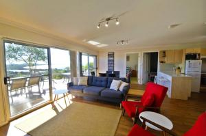 A seating area at Coastwatch, 26 Comara Terrace