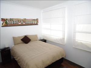 A bed or beds in a room at Jupiter, 3 Scott Street