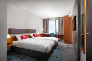 A bed or beds in a room at Ibis Ambassador Myeongdong