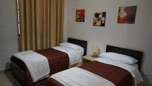 A bed or beds in a room at Appartamento A CASA MIA