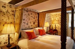 A bed or beds in a room at Ockenden Manor Hotel & Spa