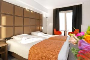 Een bed of bedden in een kamer bij Hotel Adagio