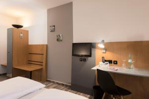 A television and/or entertainment center at ibis Styles Hotel Gelsenkirchen