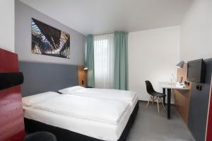 A bed or beds in a room at ibis Styles Hotel Gelsenkirchen