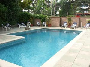 The swimming pool at or near Burley Court Hotel