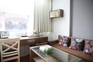 A seating area at V-Studio Apartment 2