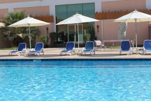 المسبح في فندق ويسترن غياثي  أو بالجوار