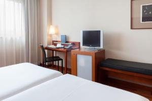 A television and/or entertainment centre at AC Hotel Alcala de Henares