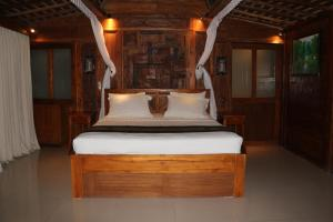 A bed or beds in a room at The Alise Villa