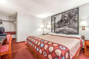 A bed or beds in a room at Super 8 by Wyndham North Bergen NJ/NYC Area