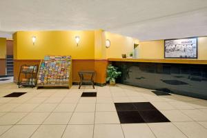 The lobby or reception area at Super 8 by Wyndham Denver Stapleton