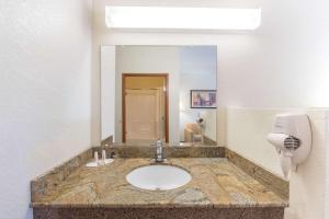 A bathroom at Super 8 by Wyndham Abilene South