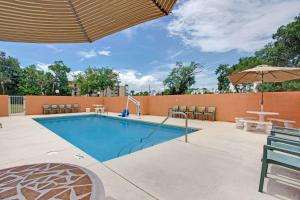 The swimming pool at or near Super 8 by Wyndham Daytona Beach