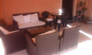 A seating area at Apartments Jela