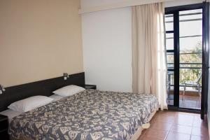 Un ou plusieurs lits dans un hébergement de l'établissement Agali Hotel