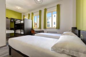 Cama ou camas em um quarto em The RomeHello