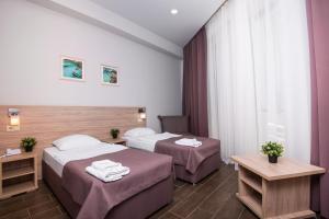 Кровать или кровати в номере Отель «Пеликан»