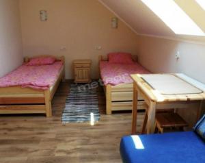 Кровать или кровати в номере Eko Zagroda Bocianie Gniazdo