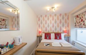 A bed or beds in a room at Thornbank House (incl off-site health club)