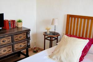 A bed or beds in a room at Cortijo de Vega Grande