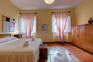 Cama o camas de una habitación en Residenza Brasca - Visitaflorencia